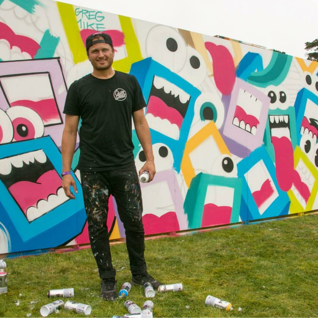 Artist Greg Mike by his work at last year's Outside Lands. Image c/o Instagram user @rangerdave.