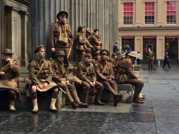 """""""Soldiers"""" sit silently outside the Royal Exchange in Glasgow in memory of the Battle of the Somme. Image c/o Gemma Swallow and BBC."""