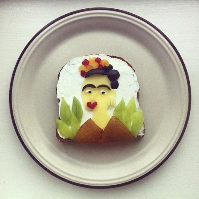 Ida Skivenes recreates famous art pieces on toast. Look--it's Frida Kahlo! Image c/o Hyperallergic and Ida Skivenes.