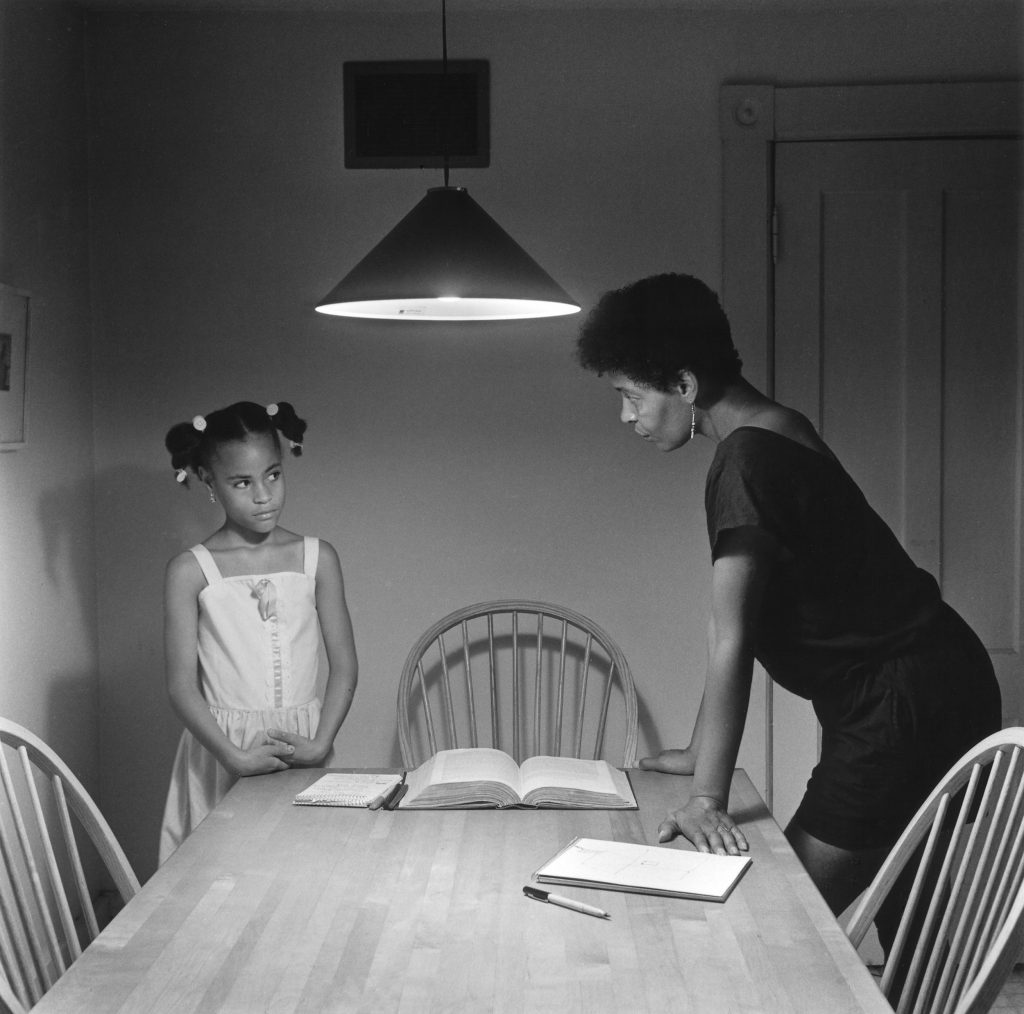 A woman faces her daughter in Carrie Mae Weems' Untitled (Woman with Daughter), . Image c/o Art Docent Program.