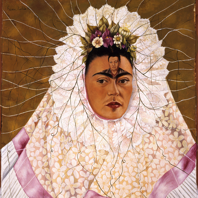 Self-Portrait as Tehuana by Frida Kahlo, featuring the artist in traditional dress with Diego Rivera's likeness painted on her forehead.
