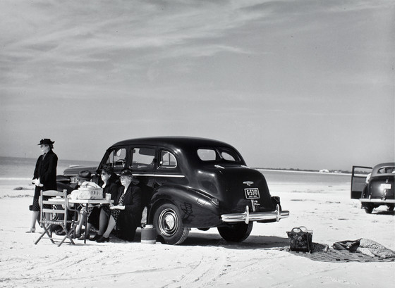 Picnic, Sarasota, Fla. Marion Post Wolcott, 1941. Image c/o LACMA. Black-and-white photograph features three women picnicking out of a car in Sarasota, FL, in 1941.