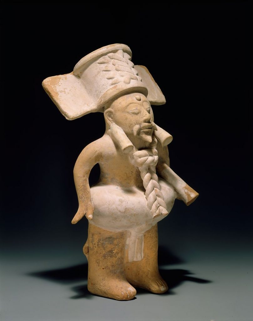 Ball Player, Unknown Nopiloa Artist, 7th-10th century. Image c/o the Met. A sculpture of a Mesoamerican ball player.